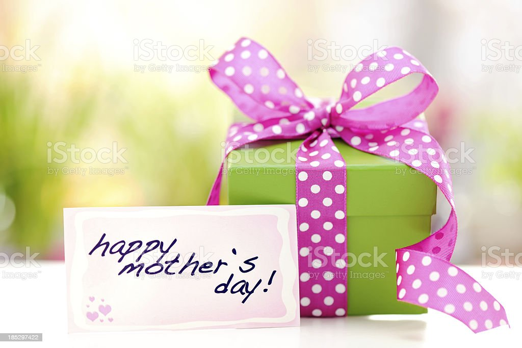 Green gift box with a mothers day card royalty-free stock photo