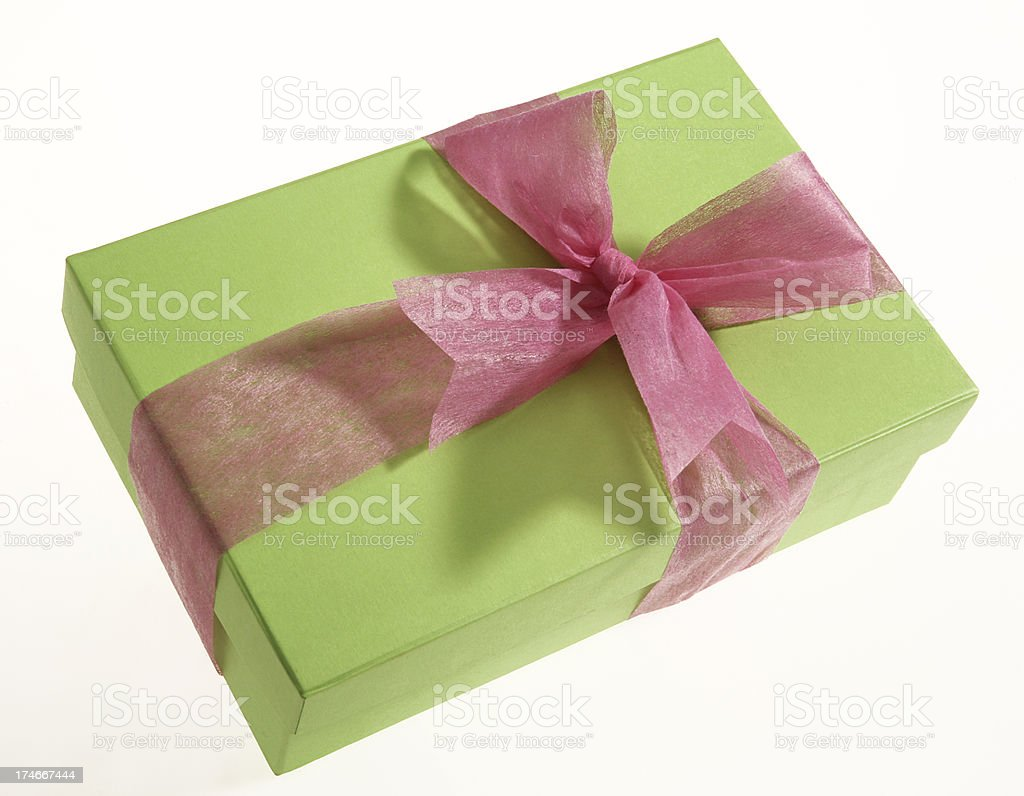 Green gift box with pink bow royalty-free stock photo