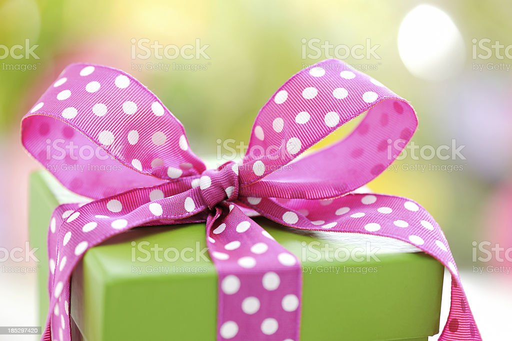 Green gift box with pink ribbon royalty-free stock photo