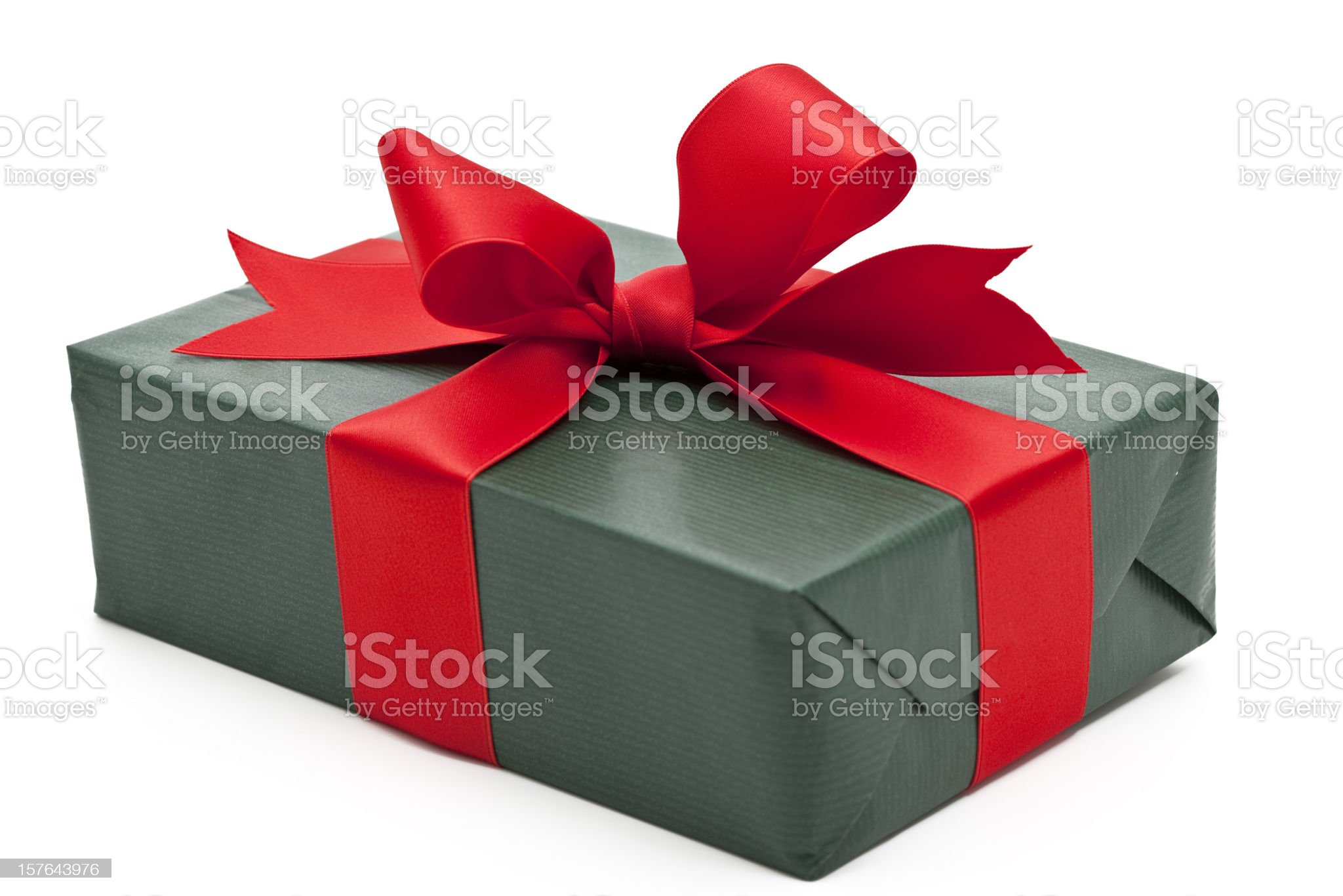 green gift box with red bow royalty-free stock photo