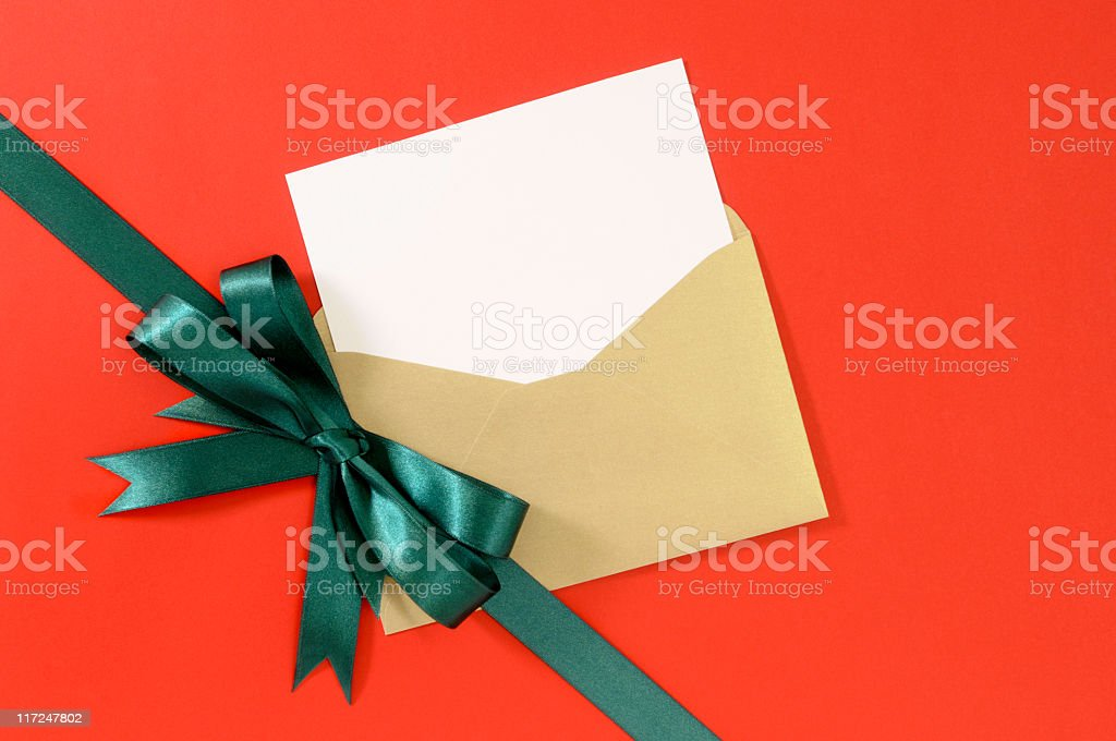 Green gift ribbon with blank message card royalty-free stock photo