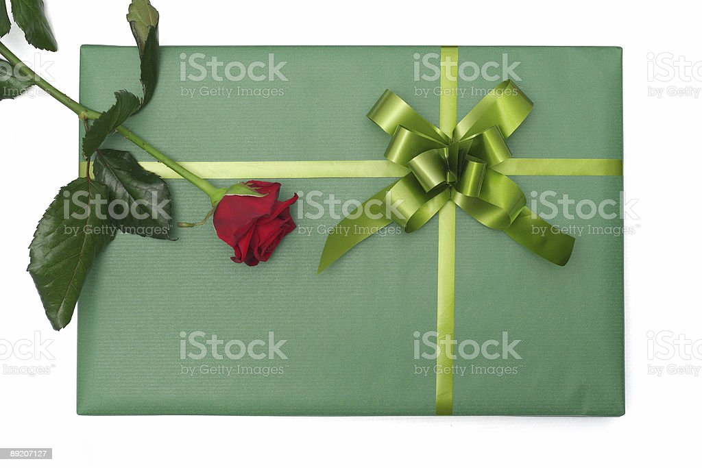 Green gift with red rose royalty-free stock photo