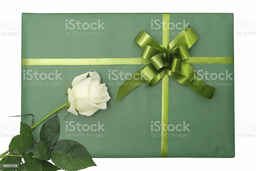 Green gift with white rose royalty-free stock photo