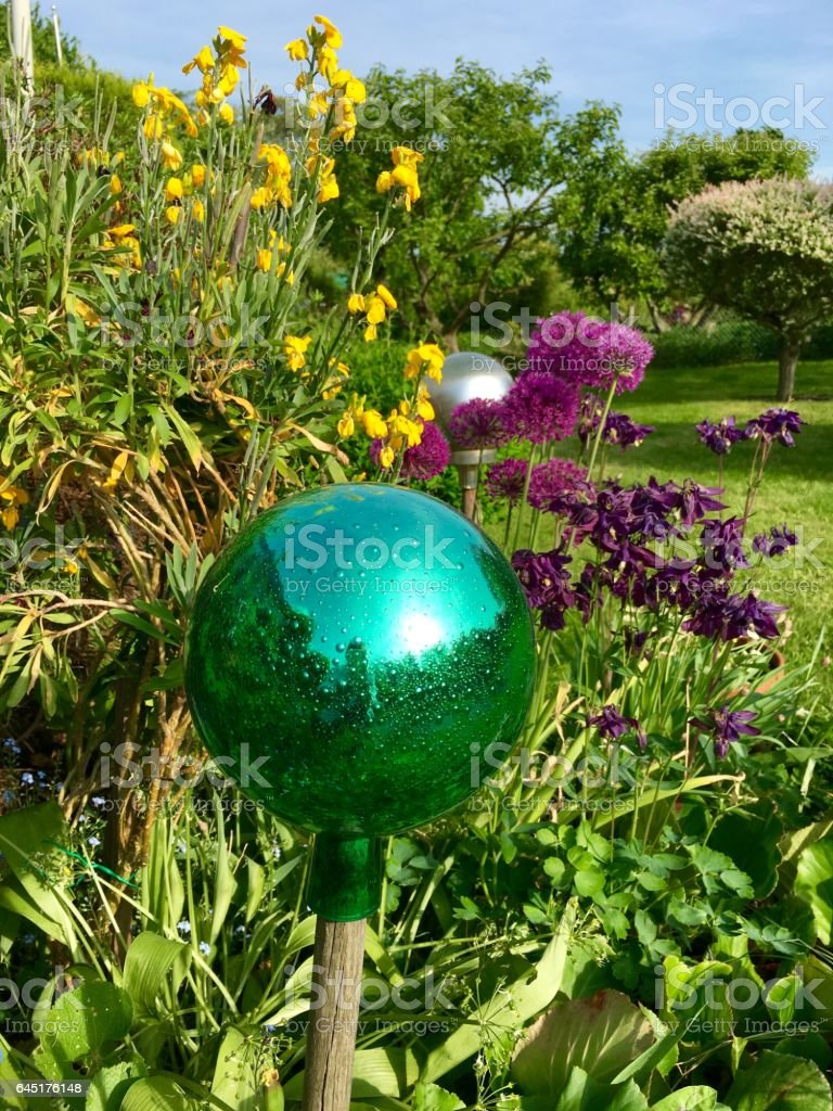 Green glass ball on a stick stock photo