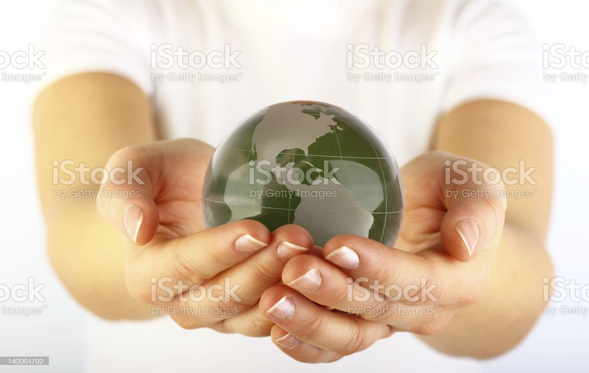 Green globe in hands royalty-free stock photo
