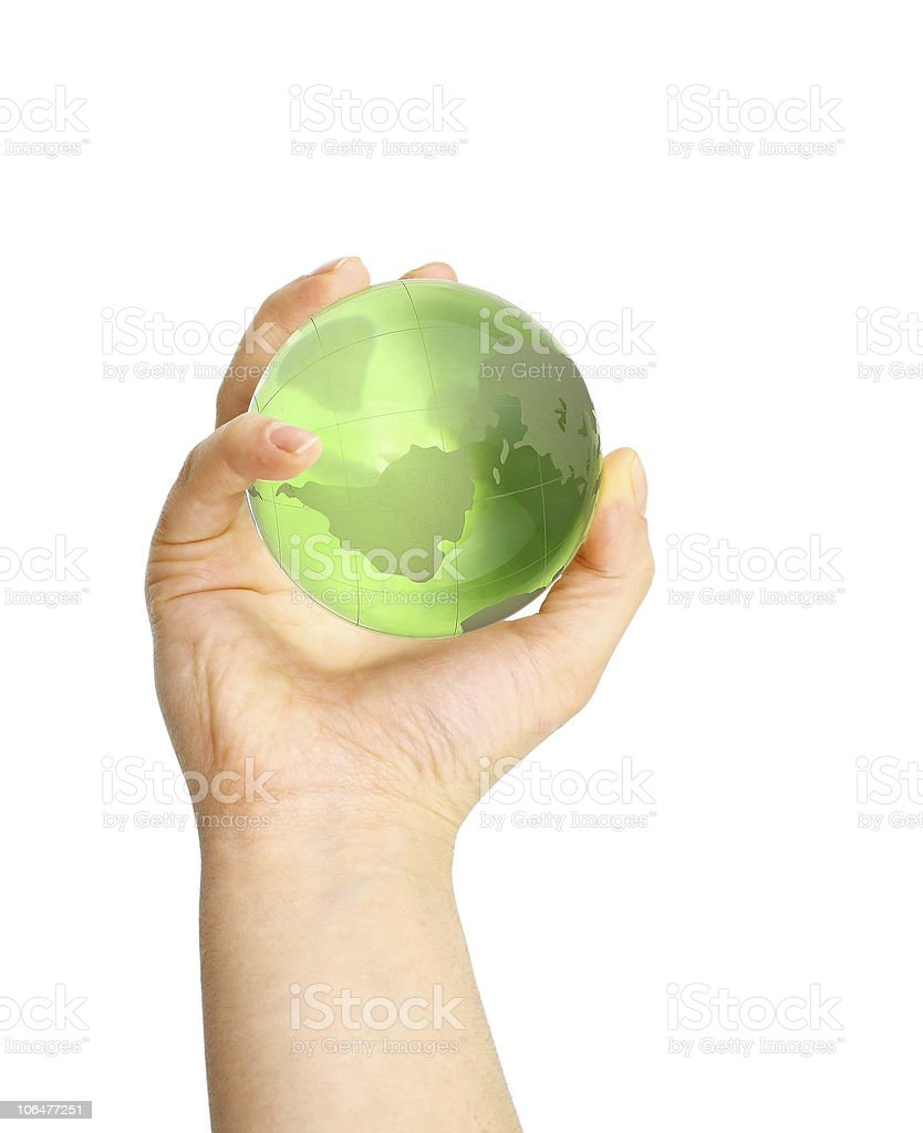 Green globe in the hand royalty-free stock photo