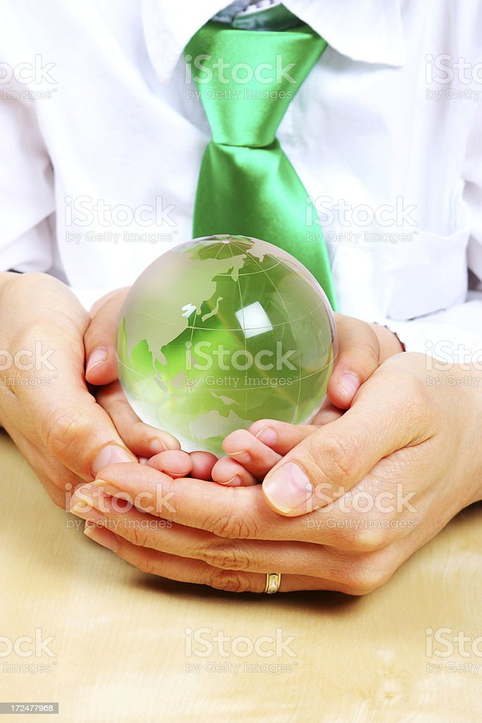 Green globe in the hands royalty-free stock photo