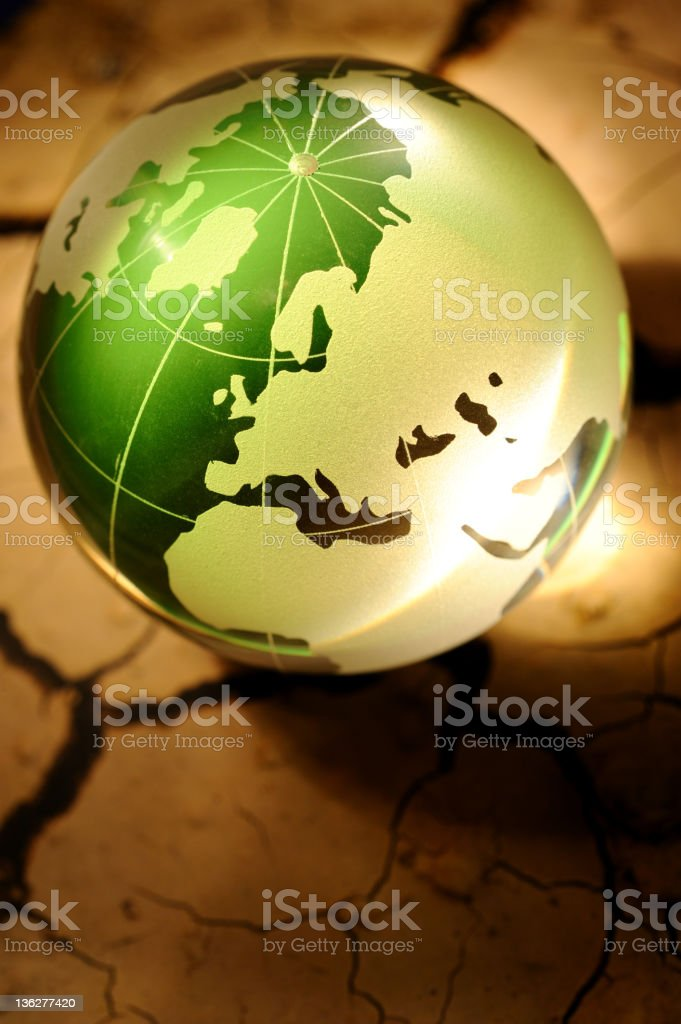 Green globe on cracked soil royalty-free stock photo