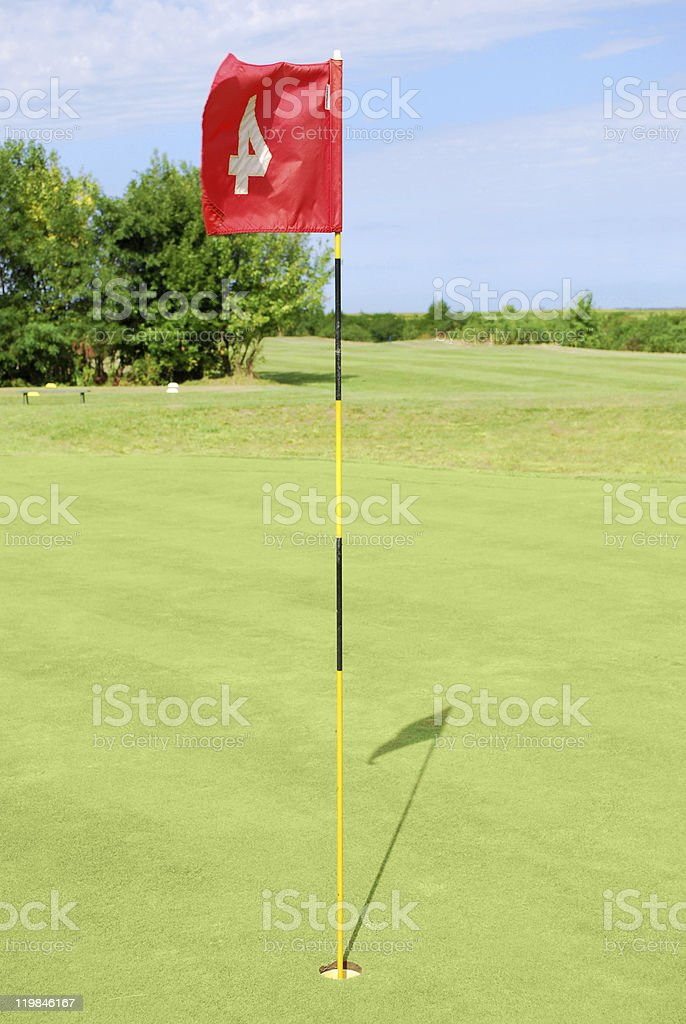 green golf field with red flag royalty-free stock photo