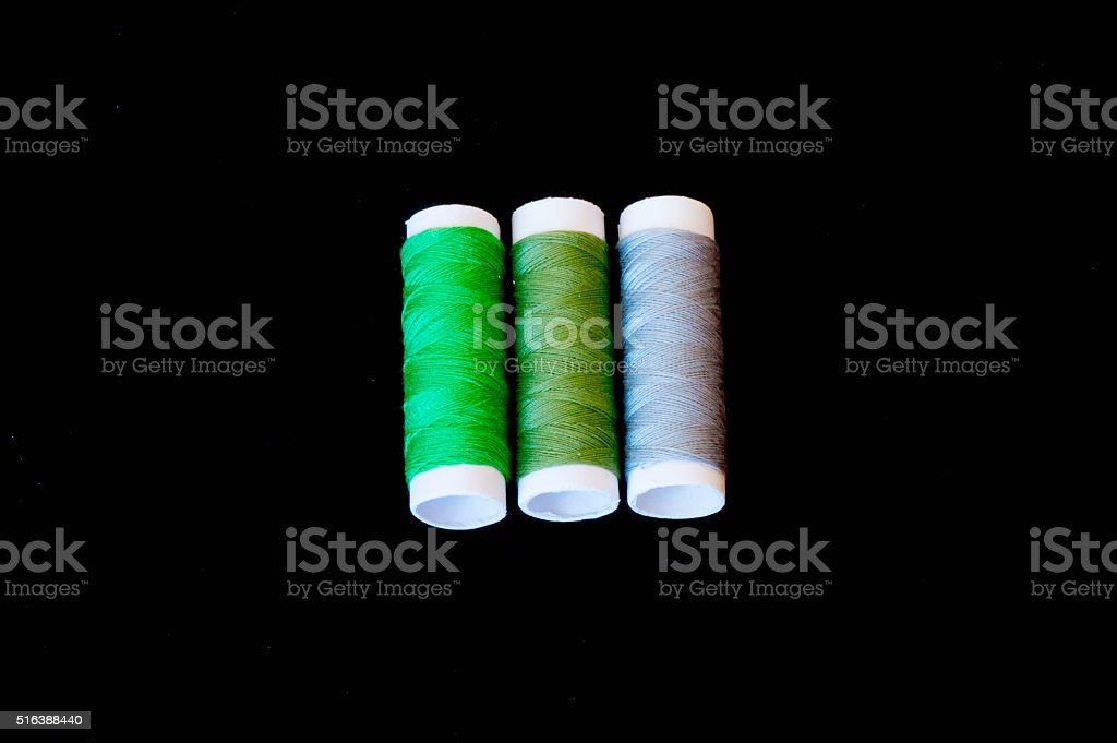 Green gradient colour threads isolated on black stock photo