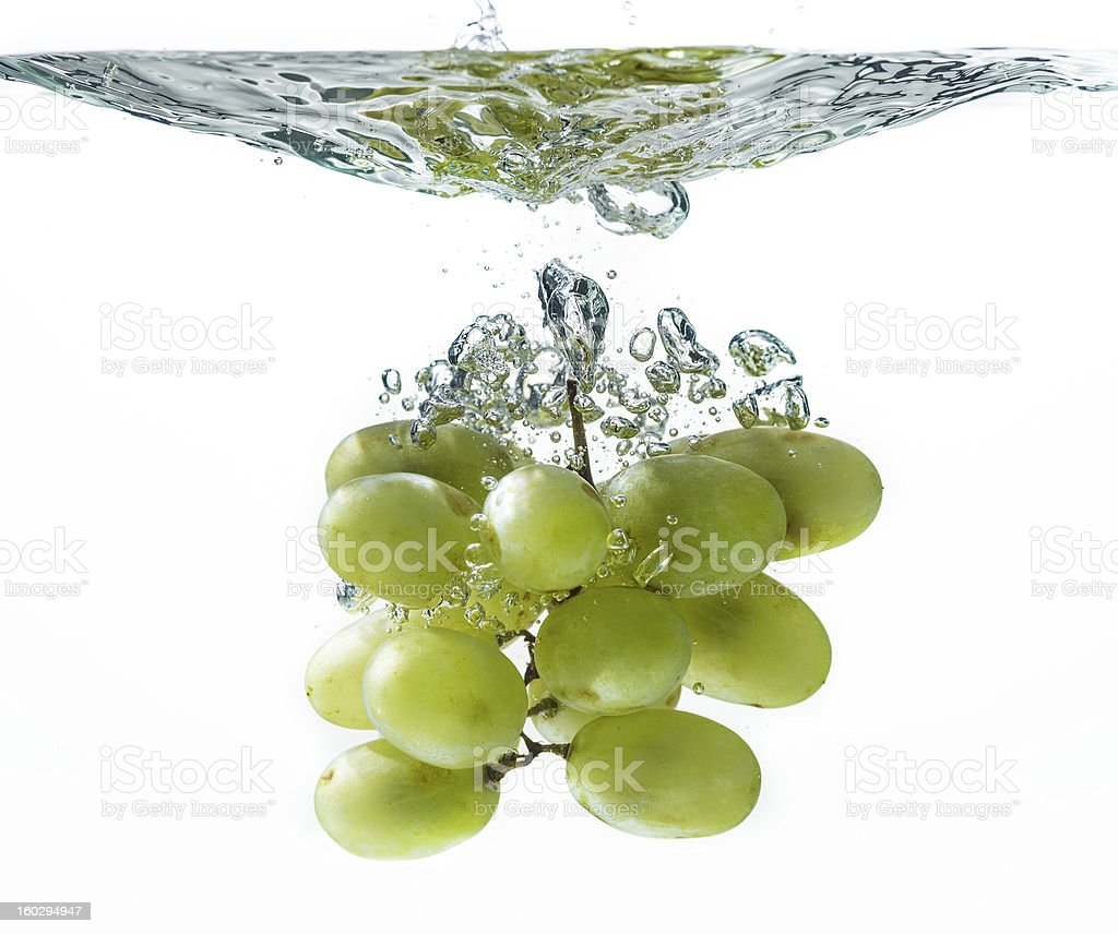 Green grape in water splash royalty-free stock photo