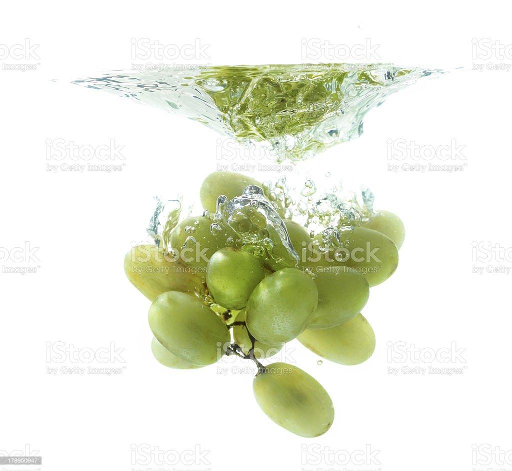 Green grape in water splash royalty-free stock photo
