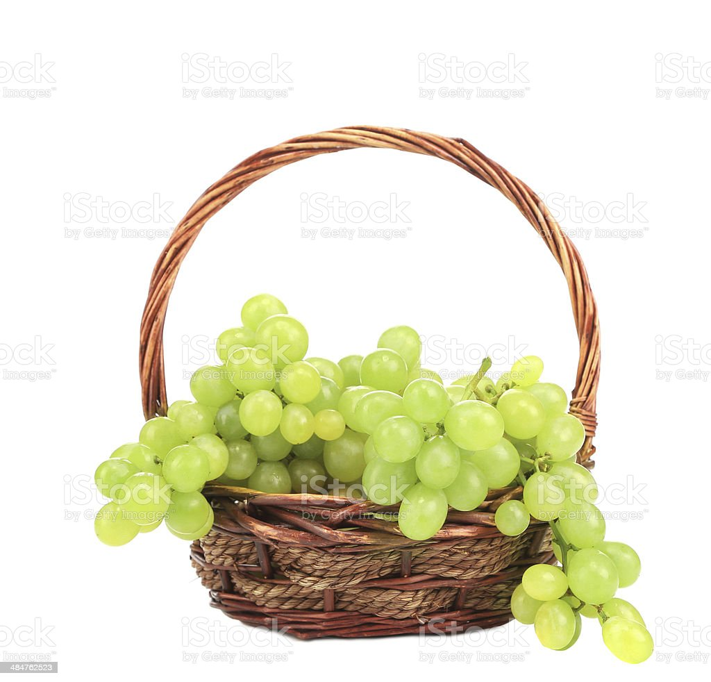 Green grapes in a wicker basket. royalty-free stock photo