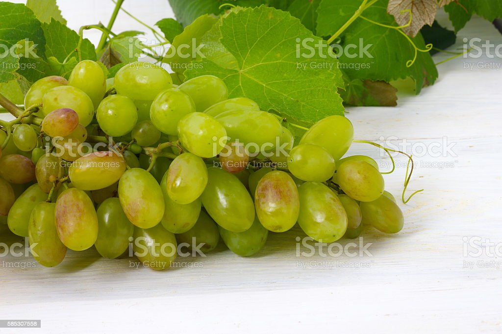green grapes on a wooden table stock photo