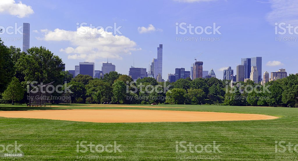 Green grass and baseball field of Central Park with Manhattan stock photo