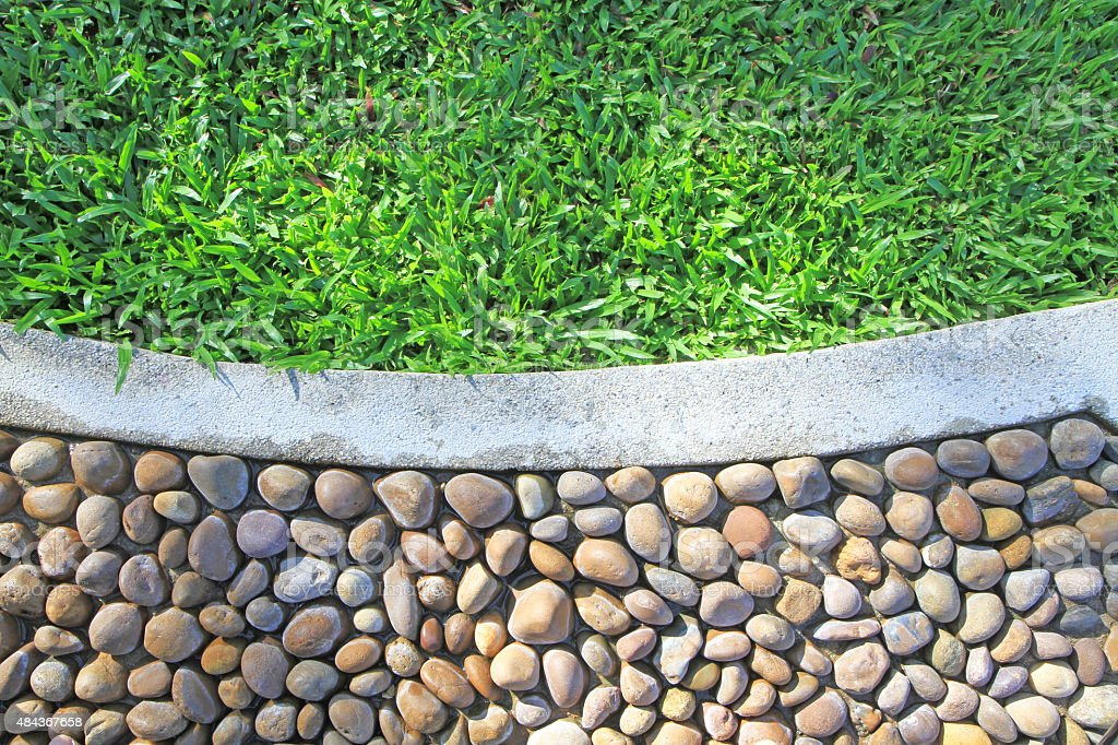 Green grass and stone floor background stock photo