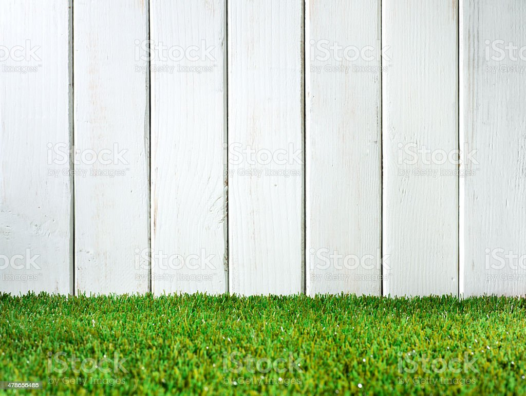 Green Grass and White Picket Fence stock photo