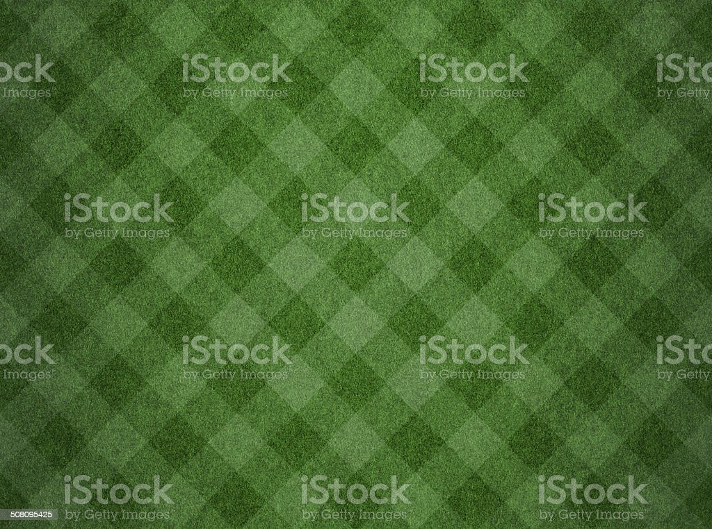 Green grass background with checked pattern stock photo