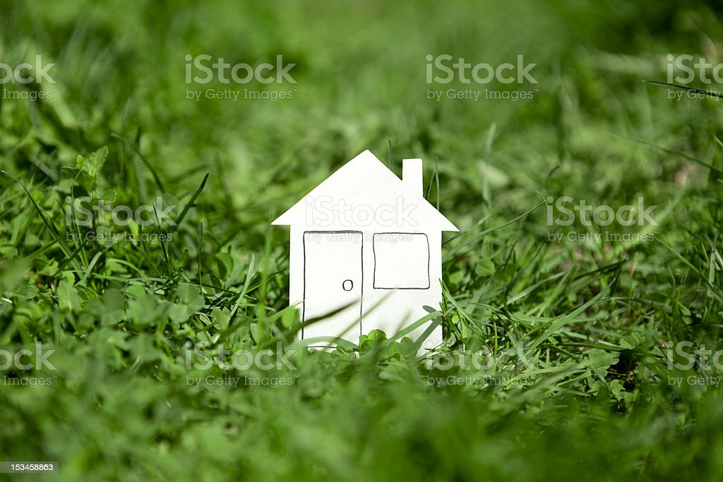 Green grass house. royalty-free stock photo