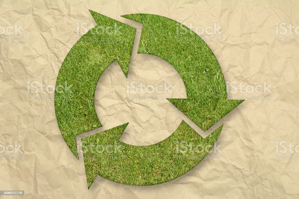 Green grass recycling symbol stock photo