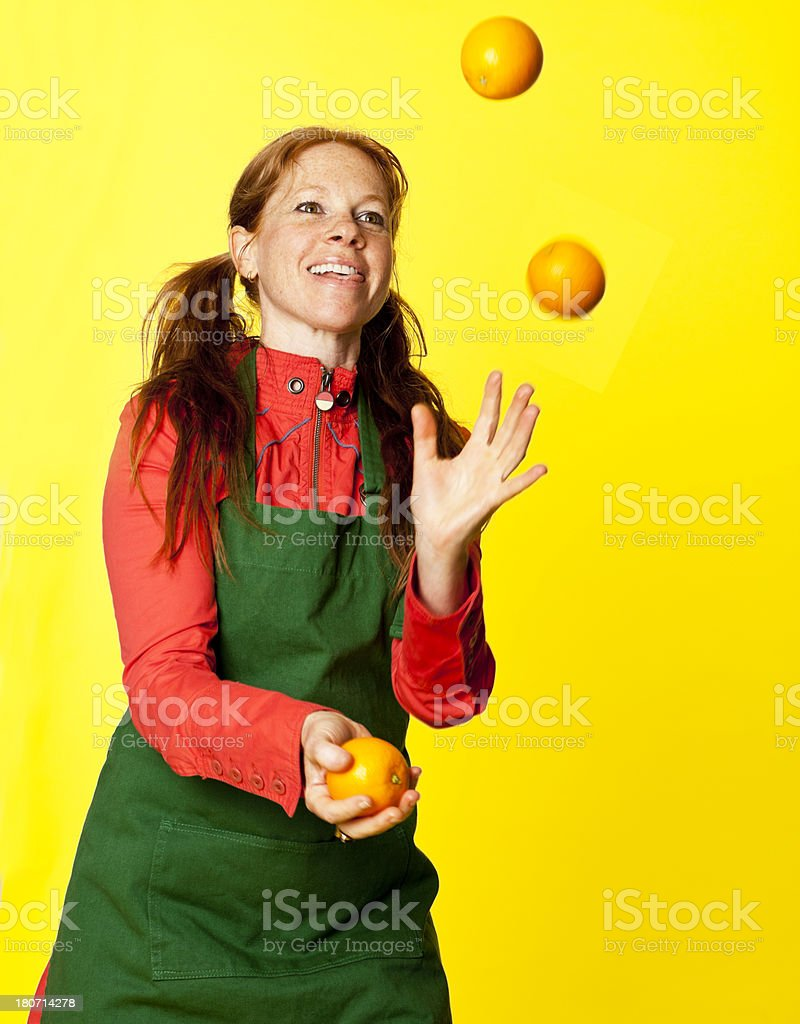 green grocer juggling oranges royalty-free stock photo
