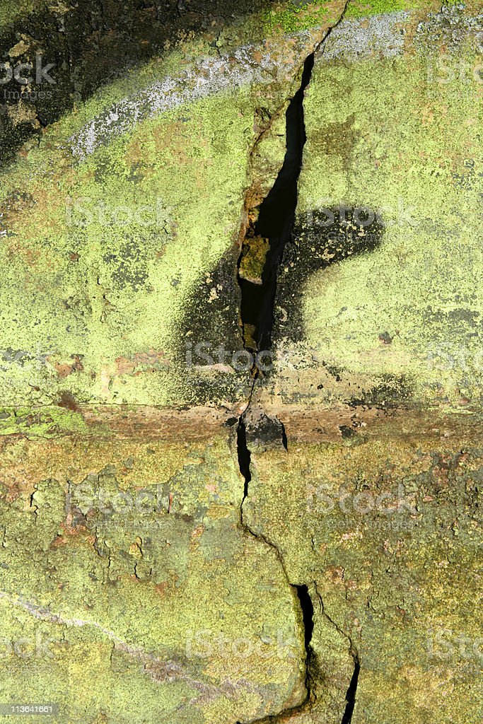 Green grunge background with big crack in the wall stock photo