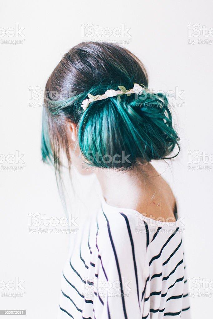 Green hair bun stock photo