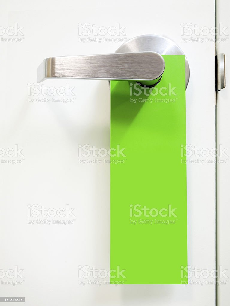 Green Hanging Door Handle Sign stock photo
