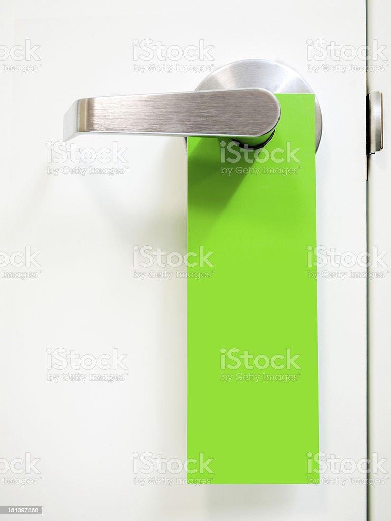 Green Hanging Door Handle Sign stock photo