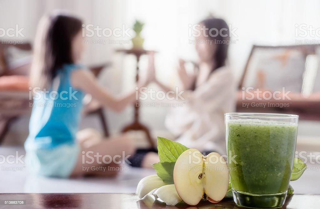 Green healthy smoothie with salad, spinach leaves and apple stock photo