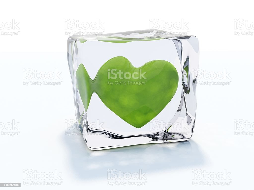 Green heart in ice cube royalty-free stock photo