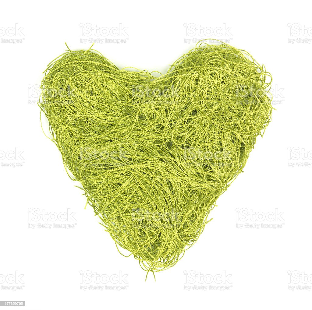 Green heart made of strings on a white background royalty-free stock photo
