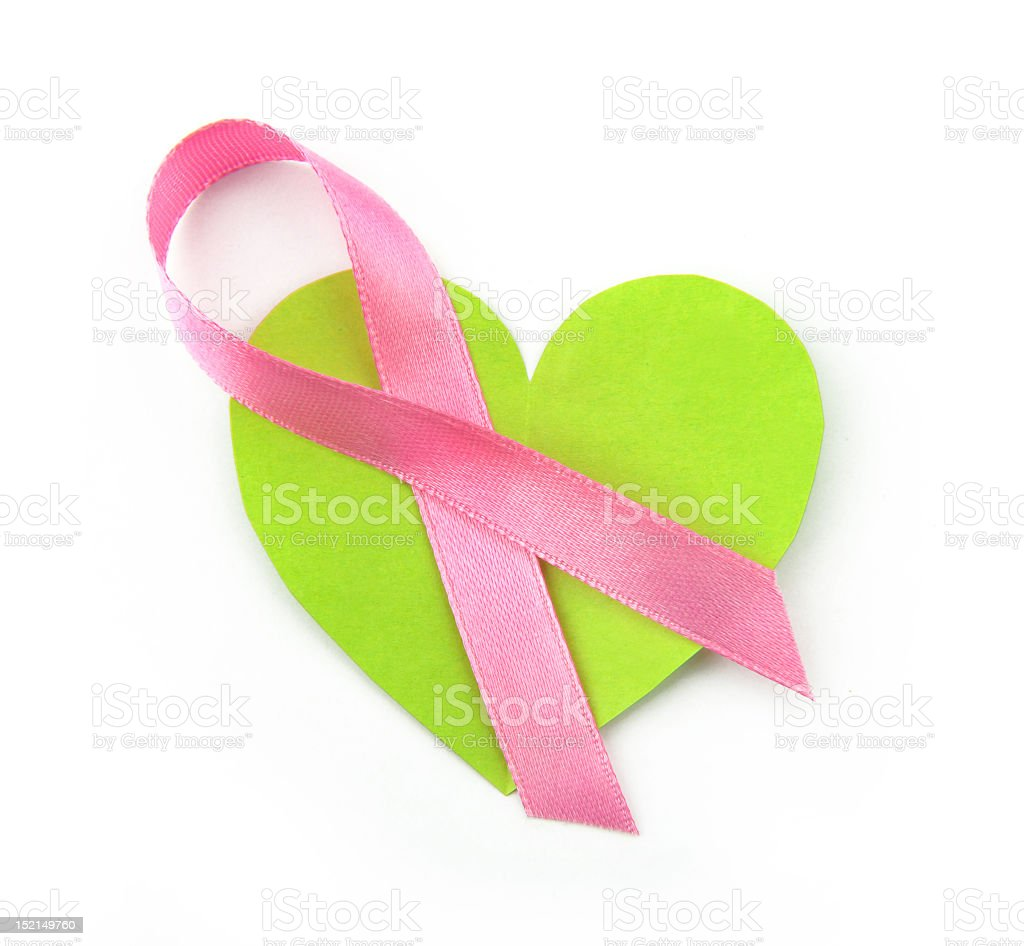 Green heart with a pink breast cancer awareness ribbon royalty-free stock photo