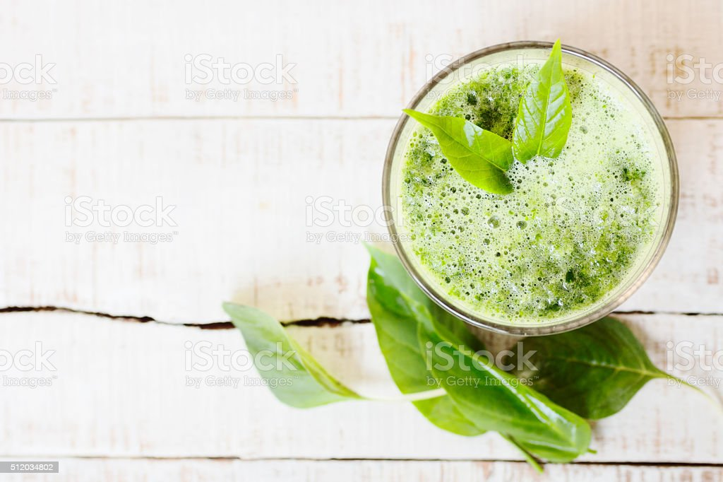 green herbal detox drink made of spinach on white wood stock photo
