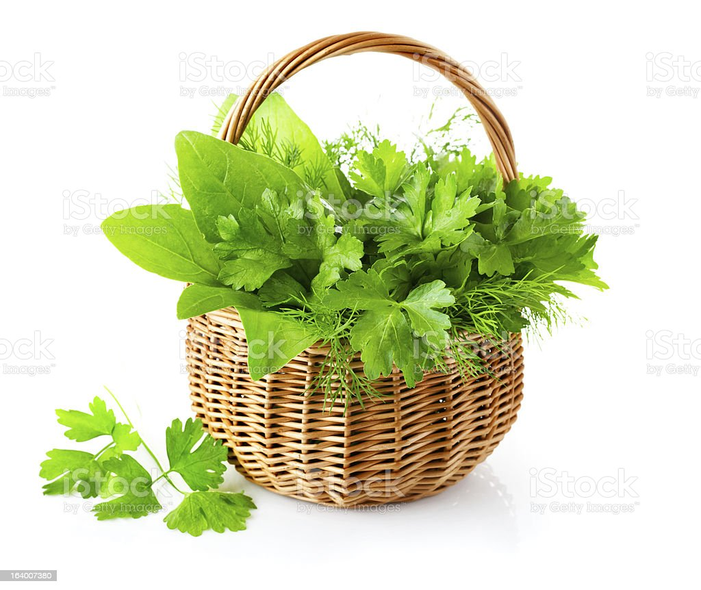 green herbs in braided basket royalty-free stock photo