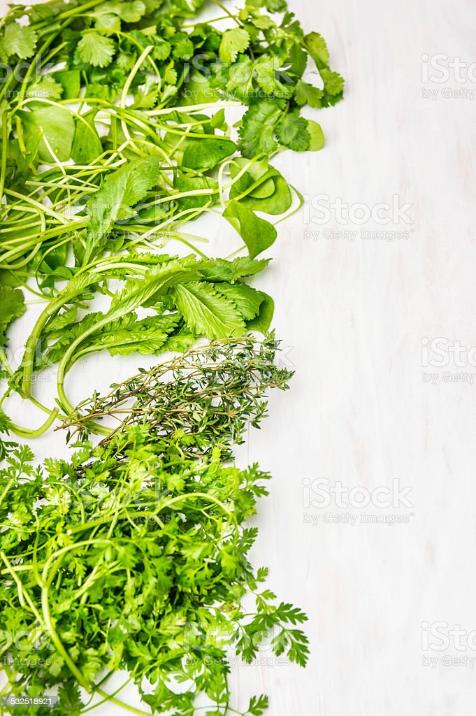 green herbs mix on white wooden background stock photo