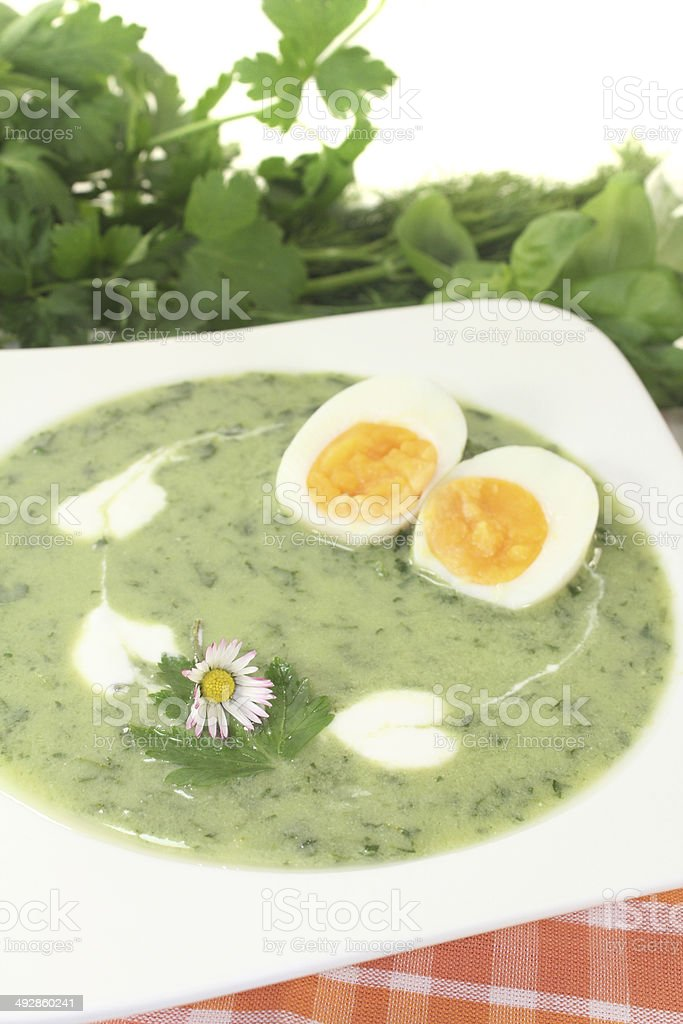 green herbs soup with eggs and a dollop of cream royalty-free stock photo