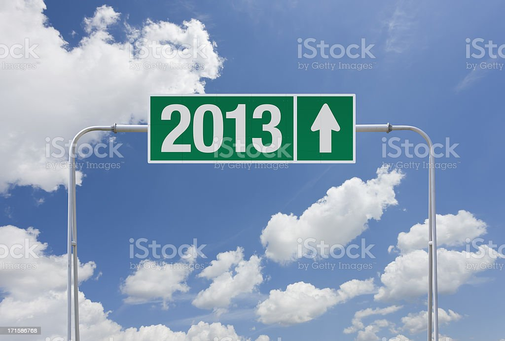 Green highway sign with exit for 2013 royalty-free stock photo