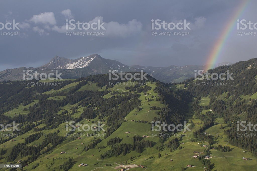 Green hill and rainbow royalty-free stock photo