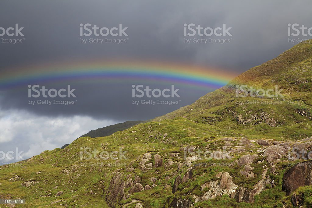 Green hill with rainbow royalty-free stock photo