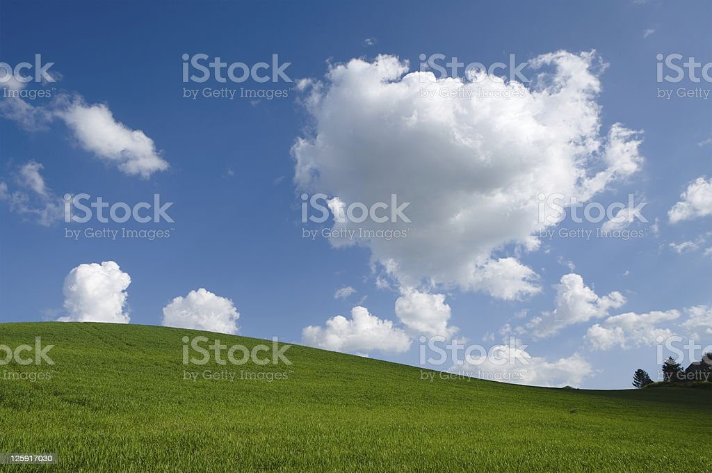 green hill with white clouds royalty-free stock photo