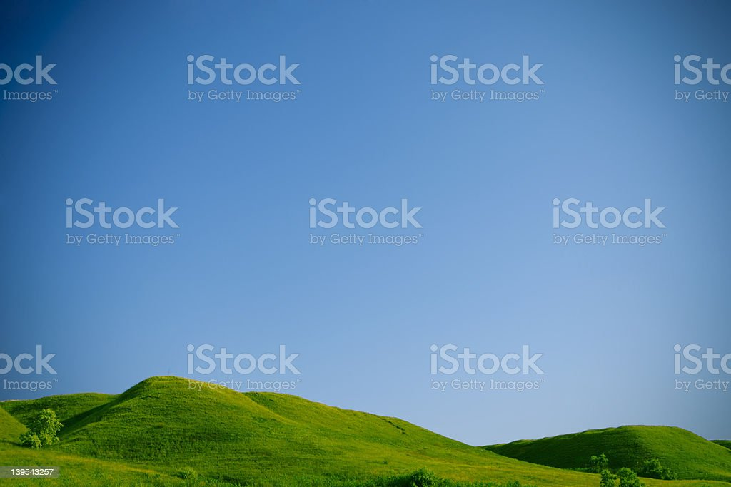 Green hills and blue sky stock photo