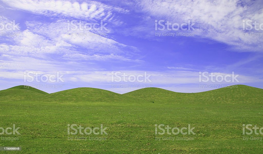 Green Hills and Blue Sky with white clouds royalty-free stock photo