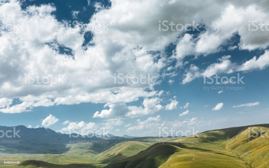 Green Hills And Mountain Range On A Sunny Summer Day. Elbrus Region, North Caucasus, Russia stock photo