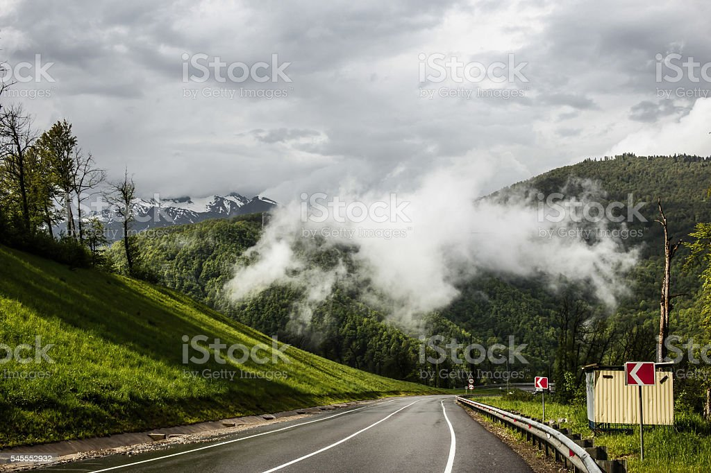 Green hills and road stock photo