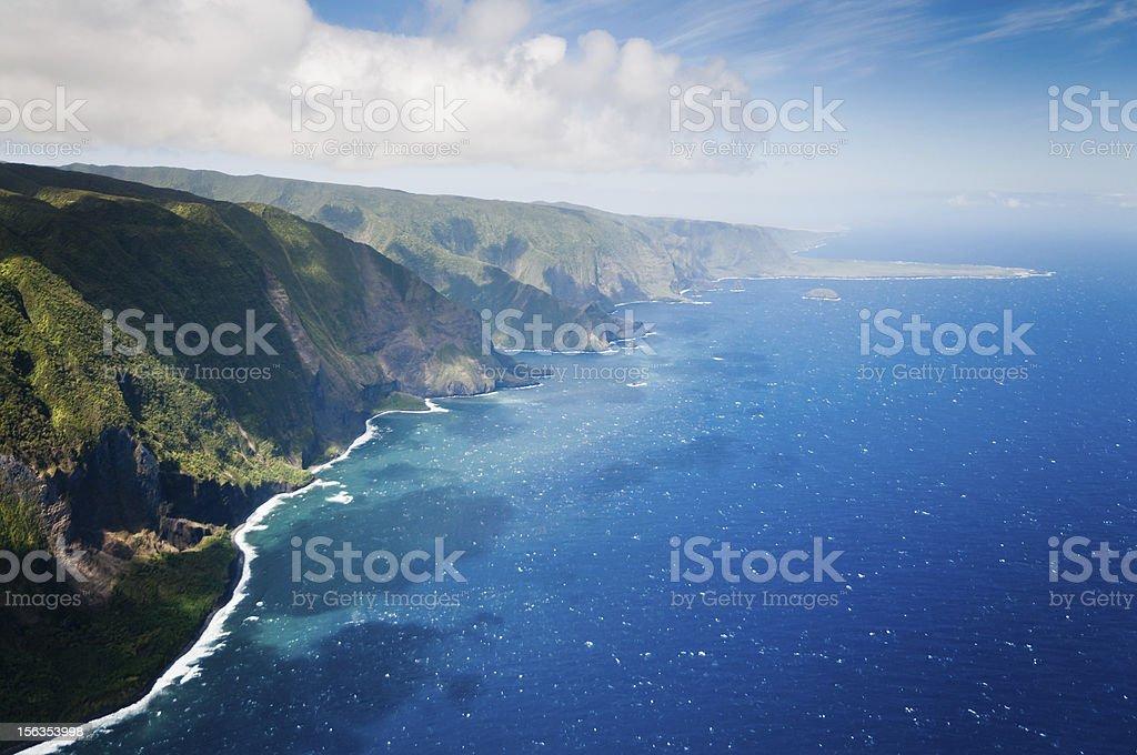 Green hills of Molokai island coastline. stock photo