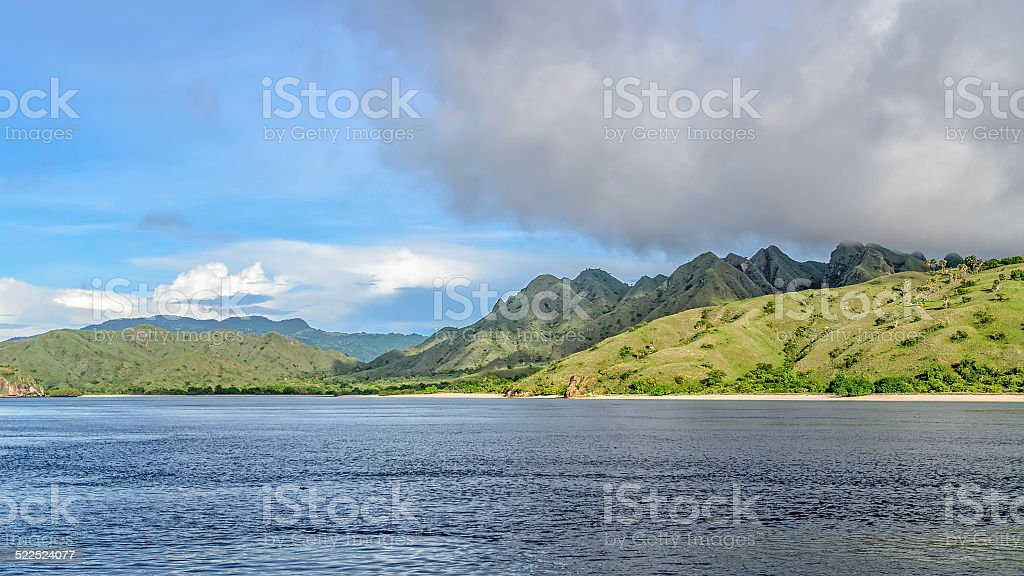 Green hills with tropical vegetation middle of the ocean. stock photo