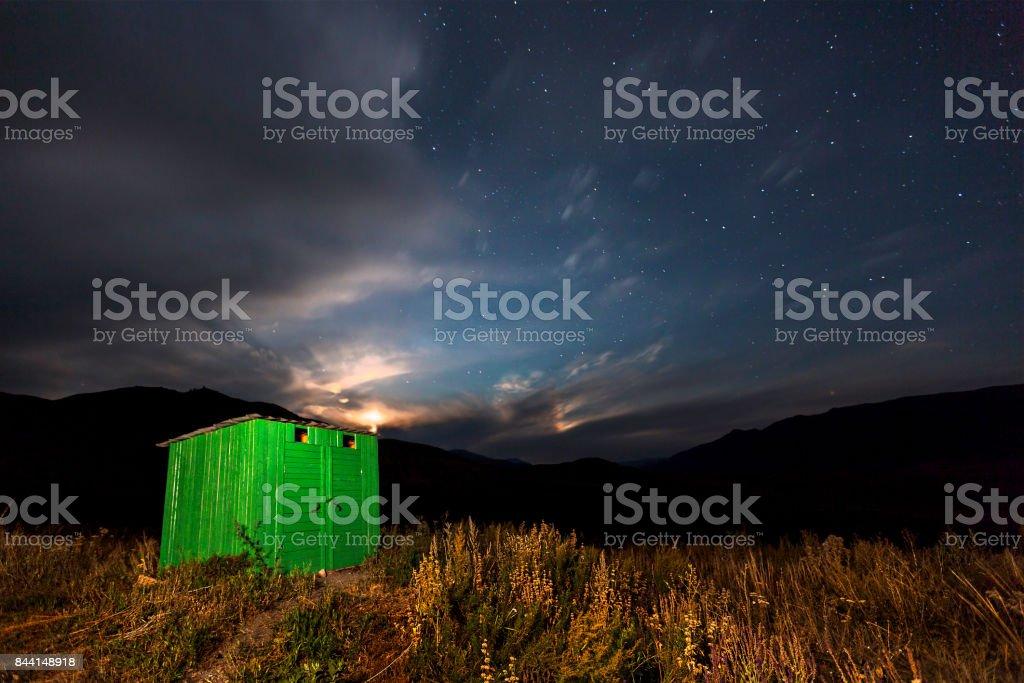 Green hut at night, Kazakhstan. stock photo