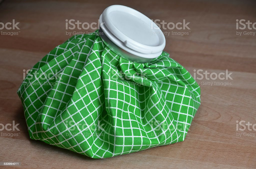 green ice bag on table stock photo