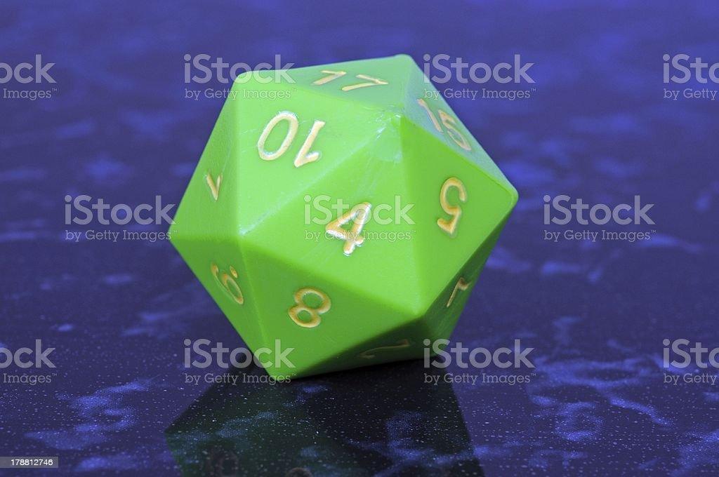 Green icosahedron die. stock photo